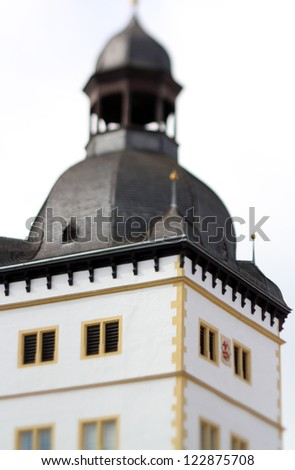 selective focus photo of a former cathedral scools tower in paderborn - stock photo