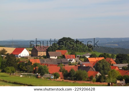 selective focus photo of a small village in central germany - stock photo