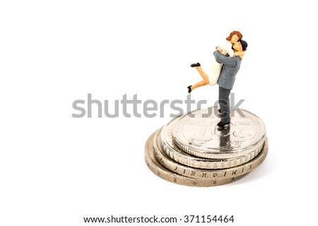 selective focus photo of miniature couple on euro coins on white background, abstract background to money and saving concept. - stock photo