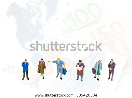 selective focus photo of miniature standing over euro coins,map,banknote on white background, abstract background to money and saving concept.