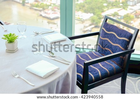 Selective focus point at Luxury banquet table near window river view - stock photo