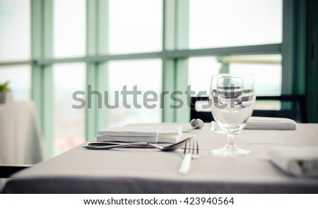 Selective focus point at Luxury banquet table near window , Vintage Light filter - stock photo
