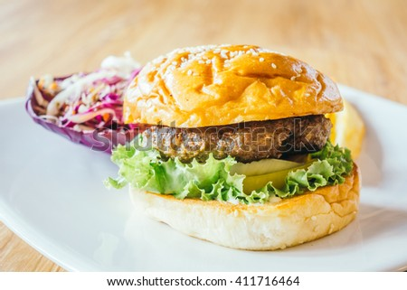 Selective focus point on Beef hamburger - Junk food style and Filter Effect processing