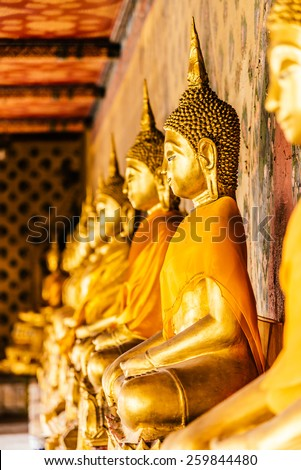 Selective focus point on Buddha statue in wat arun from thailand bangkok - vintage effect style pictures