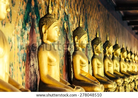 Selective focus point on Buddha statue in wat arun from thailand bangkok - vintage effect style pictures - stock photo