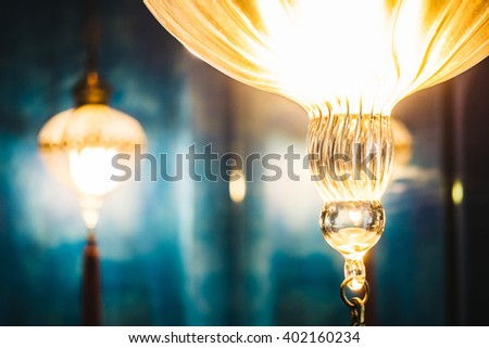 Selective focus point on Morocco light lantern decoration in living room interior - Vintage Light Filter - stock photo
