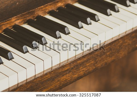 Selective focus point on Old vintage piano keys - vintage filter effect