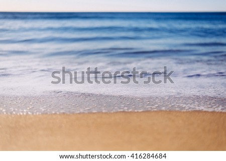 Selective focus. Relaxing and gentle calming waves flowing - stock photo