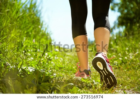 selective focus.. runner feet closeup. athlete in the park outdoors. running shoes. jogging - stock photo