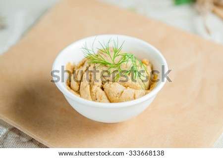 Selective focus Set of Traditional Eastern appetizer hummus in the white plate  on served in eco style restaurant table - stock photo