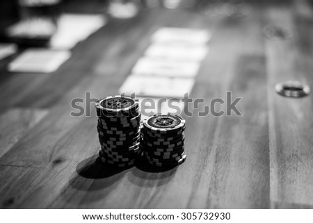 selective focus shot of poker chips and playing cards - stock photo