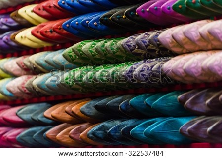 selective focus shot of traditional moroccan shoes - stock photo