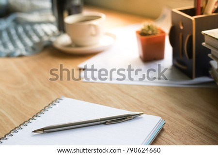 Selective focus table : notebook and pen on the wooden table.working Business concept with effect light added