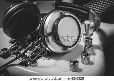 selective focus the  headphones on electric bass by music production band concept.
