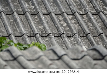 SELECTIVE FOCUS TO ZINC METAL ROOF TEXTURE BACKGROUND IN NATURE DAY LIGHT - stock photo
