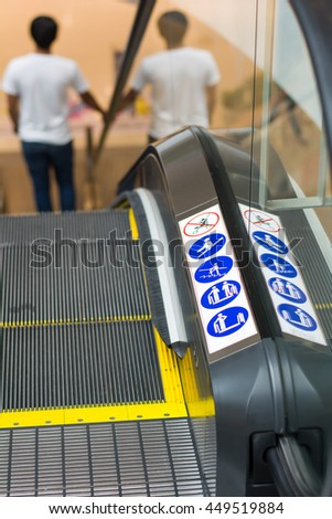 Selective focus top view of escalators with detail  signs of symbols.copy space. - stock photo