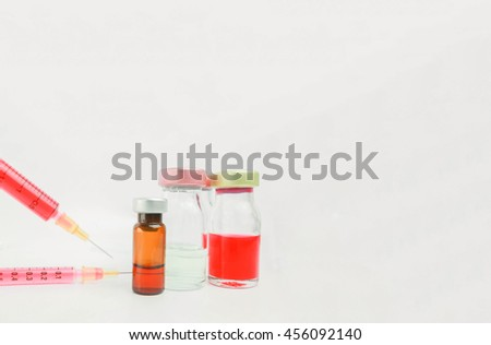 Selective focus vial and syringes with blurred background in the hospital. : medication,vaccine, drugs, blood, laboratory. Copy space. - stock photo
