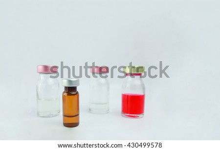Selective focus vial  on isolate the white background .  : medication, drugs, blood, laboratory. - stock photo