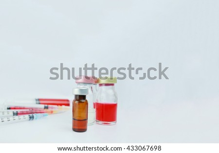 Selective focus vials and blurred syringes  in the hospital. : medication, drugs, blood, laboratory. Copy space. - stock photo