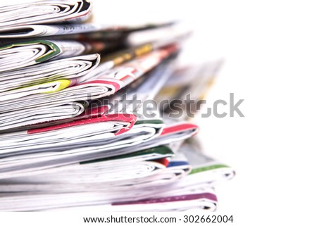 selective focus with shallow DOF of closeup stack of the newspaper - stock photo