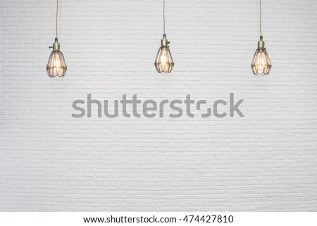 Selective focused on vintage light bulbs with blurry white brick background