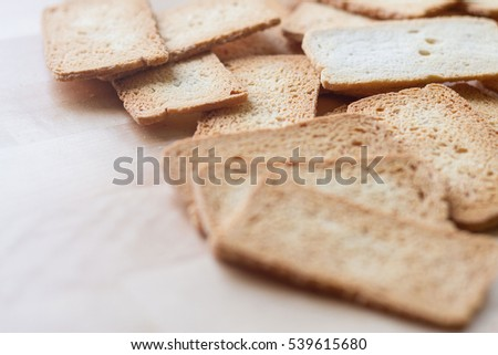 Selective focused shot of crackers on wooden table, a sort of biscuit , brown cracker