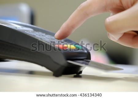 selective on a finger hand of people use credit card for payment an online shopping with blurred background  - stock photo