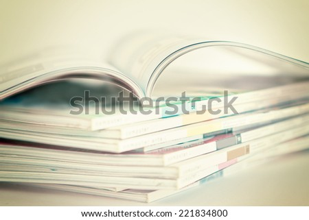 selective soft focus of open and Stacking of magazines  - stock photo