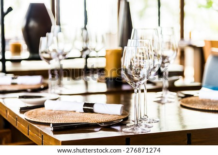 Selective soft focus on Wine glass on dining table in restaurant - stock photo
