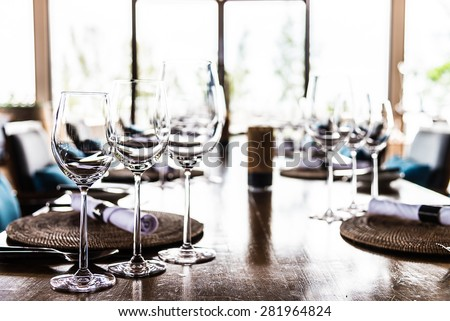Selective soft focus on Wine glass on dining table in restaurant