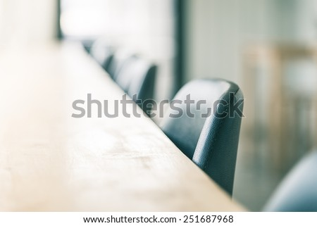 Selective soft focus point on chair in coffee shop - vintage effect
