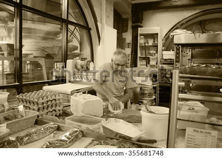 SELESTAT, FRANCE - DECEMBER 20, 2015: Baker preparing dough for Christmas pastries at Bread house (La Maison du Pain). Selestat, located on Alsace wine route, is known as home of Christmas tree.