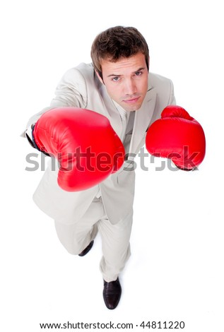 Self-assured attractive businessman beating the competition against a white background