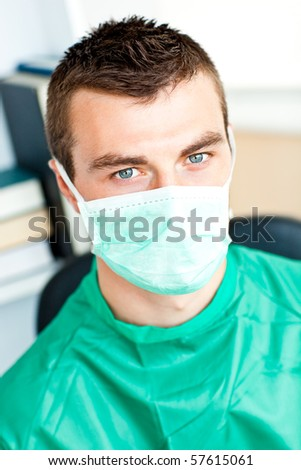 Self-assured male surgeon looking at the camera