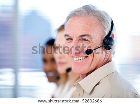 Self-assured sales representative team with headsets against white background - stock photo