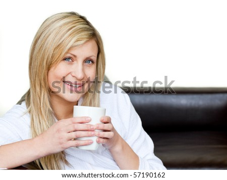 Self-assured woman holding a cup of coffee against a white background
