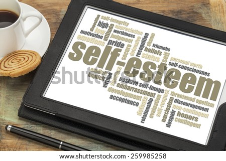 self-esteem word cloud on a digital tablet with cup of coffee - stock photo