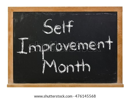 Self Improvement Month written in white chalk on a black chalkboard isolated on white