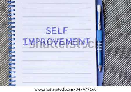 Self improvement text concept write on notebook with pen