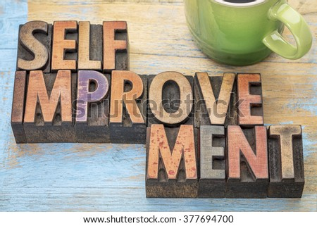 self improvement  - word abstract in letterpress wood type printing blocks stained by color inks with a cup of coffee - stock photo