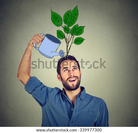 Self investment. Young man with many ideas - stock photo