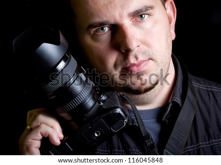 Self portrait of the photographer with DSLR camera - stock photo