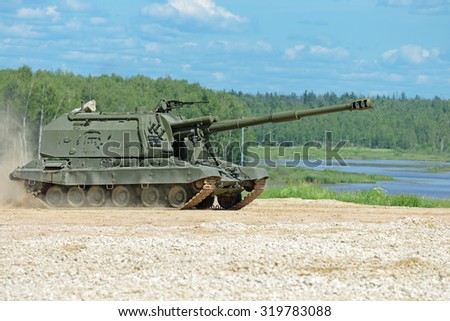 Self-propelled howitzer on the fighting position on the riverside, nobody - stock photo