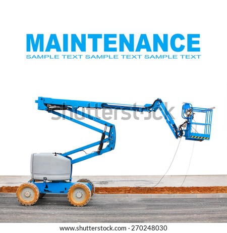 Self propelled hydraulic lift (platform) with space for your text. - stock photo