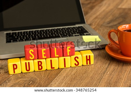 Self Publish written on a wooden cube in a office desk - stock photo