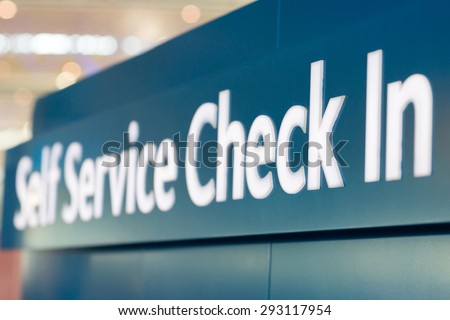 self service check in sign at airport - stock photo