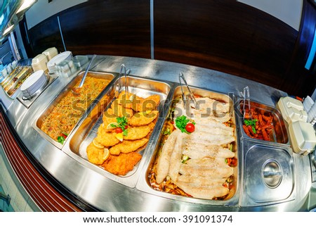 Self service restaurant with a variety of salads, soups and side dishes - stock photo