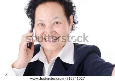 Selfie,Business Senior woman with talking cellphone expression over white background