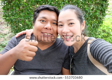 selfie couple,making selfie on camera cheerfully