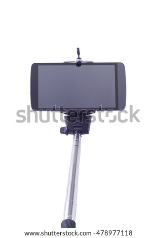 selfie monopod and cellphone . Isolated on white background . With clipping path included